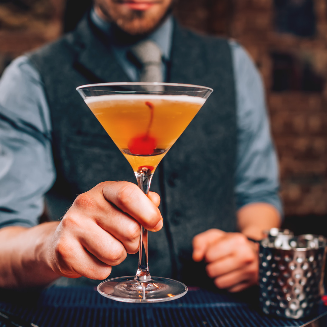 bartender-serving-manhattan-cocktail-in-