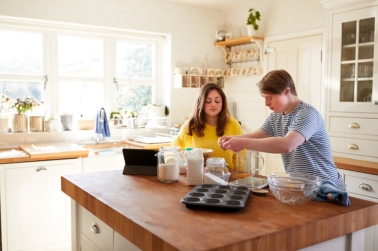 young-downs-syndrome-couple-baking-in-ki