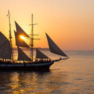 sailing-ship-at-sunset-P6U4ECE.jpg
