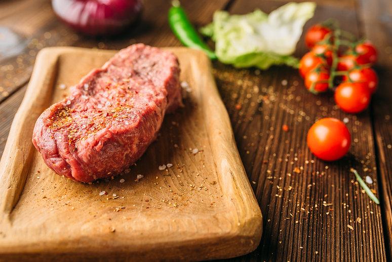 juice-piece-of-steak-in-seasoning-and-ve