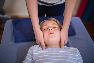 high-angle-view-of-boy-receiving-neck-ma