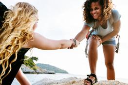 young-women-helping-each-other-7B9YNQA.j