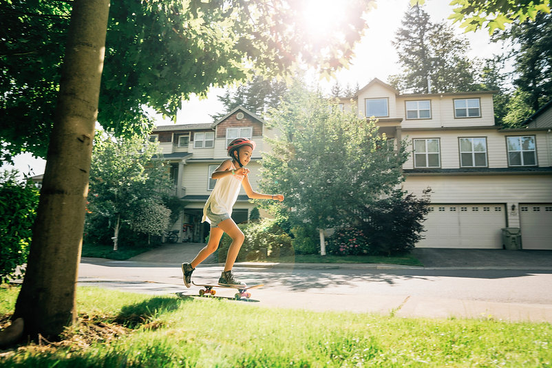 tween-girl-skating-on-skateboard-on-side