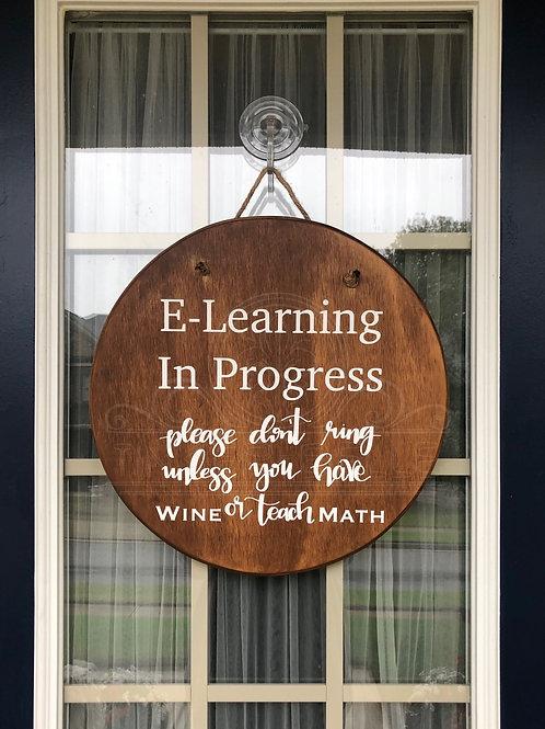 """E-learning in progress"" wood door hanger"
