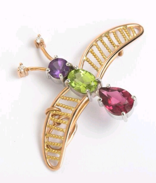 Broach in 22kt & 18kt gold with Peridot , Amethyst , Tourmaline & brilliant diamonds