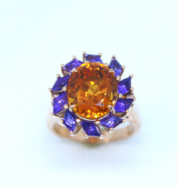 Ring in 18kt pink gold with an Amethyst  and Citrines