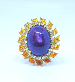 Ring in 18kt gold with a star Ruby, Citrines and brilliant diamonds