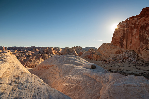 The suns last rays over the landscape of the Valley of Fire State Park, Nevada, USA