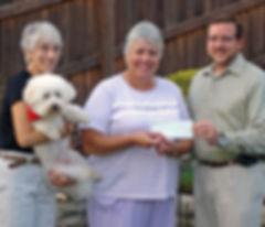 1. Lynn Ramich Receiving Check from  Matt Abbott; Mary Ann Birsa & Pepper Observe_edited-1.jpg