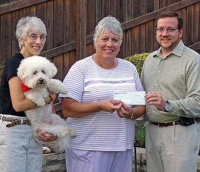 1. Lynn Ramich Receiving Check from  Matt Abbott; Mary Ann Birsa & Pepper Observe_edited-1.jpg