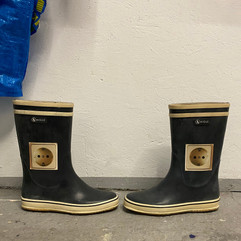 Mina Mania's electric rubber boots