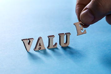 VALUE from wooden letters on a blue back