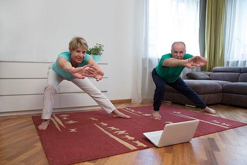 active senior couple doing stretching ex