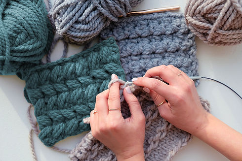 Closeup of person's hands knitting