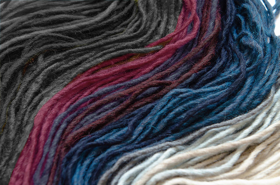 A close up of a variety of coloured yarn