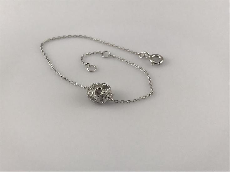 Bracelet argent 925/1000 rhodié avec une tête de mort en oxyde de zirconium