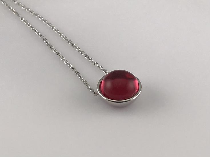 Collier en argent 925/1000 rhodié orné d'un cristal couleur rouge rubis