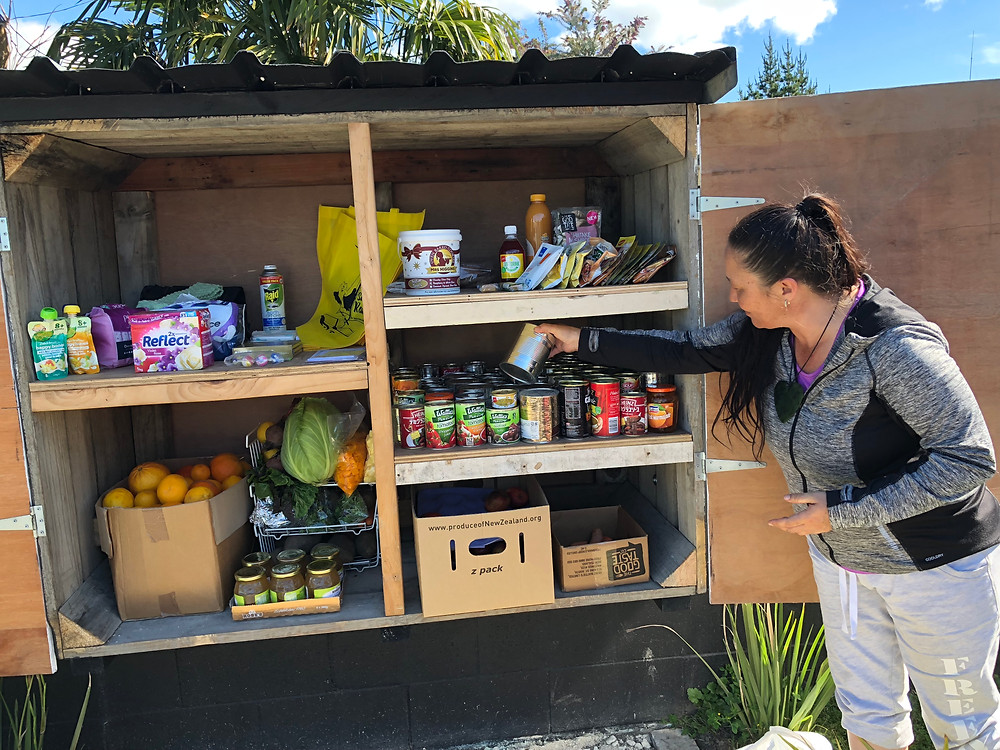 Stocking up: Lynsey Abbott adds donated tin food to the pantry shelves.