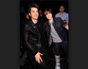 Singer John Mayer is happy Justin Bieber called off his tour.