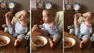 Baby girl learns how to feed herself with no arms, this is amazing.