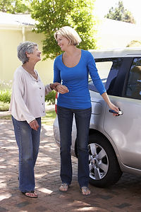 Woman Helping Senior Woman Into Car.jpg