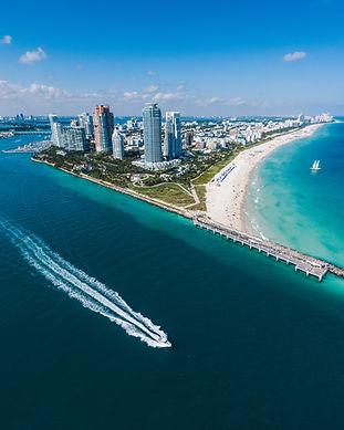 Aerial view of Miami Beach with speedboa