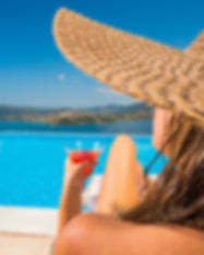 Woman holding a fresh cocktail relaxing