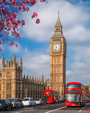 London with red buses against Big Ben du