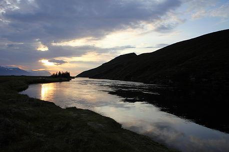 Midnight sun on the BIg Laxa Iceland