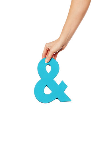 Female hand holding up a blue ampersand