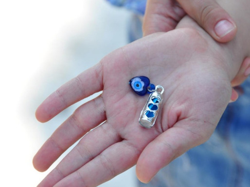 LUCKY CHARM: Work it with the evil eye and ward off the wicked.