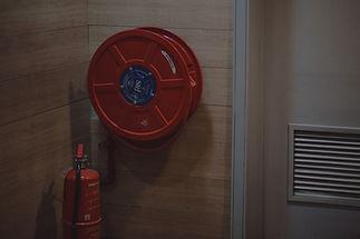red-fire-extinguisher-beside-hose-reel-inside-the-room-189474_edited.jpg