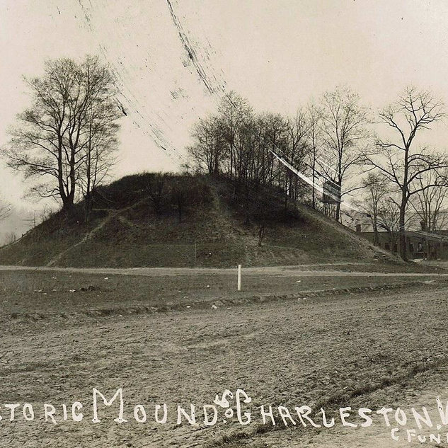 South Charleston Indian mound with Banner Glass on the other side of McCorkle Ave. which runs between the two.