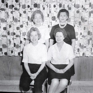 Thought to be wives of Rolland company personnel.