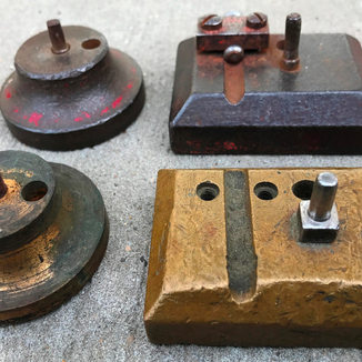 Krages two style anvils in polished brass or painted steel.