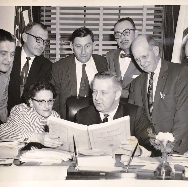 Rene Zabeau second from left working with govenor Arch Moore in Charleston.