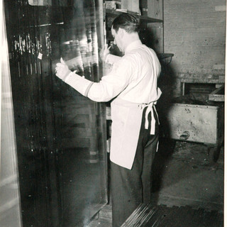 In this next series of photos, Howard Kline a glass cutter, would render a sheet of glass into desired sizes.