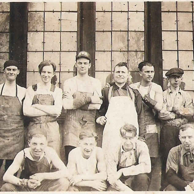 Glass cutters at the Equitable plant.  Gus Quertinmont third from the left, standing.