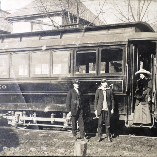 this streecar on North Hamill Ave. brought many workers to the Rolland plant.  The lady is thought to be the wife of one of the Rolland brothers.