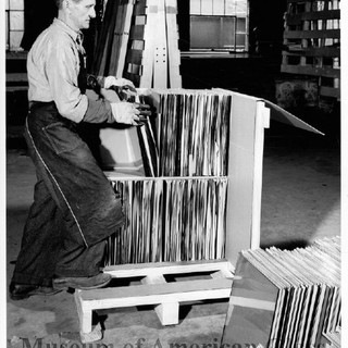 After a single piece of paper was placed in between each lite of glass to protect it while in shipping, the glass was either put in small boxes or pallets as this packer is demonstrating.  Weston Glass Museum