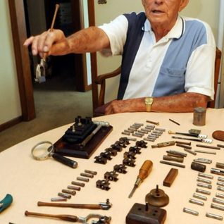 BoB Deahl, 88, in July 2011 as he appeared in the Charleston Gazette newspaper.  Bob is showing off some of his tools he used to cut glass back in the day at Libbey Owens.