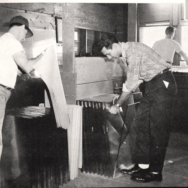 Glass cutter Art Lefever, stall #34.  Rolland paper boy Cub Barett and sticker boy Howard Quinn attending to Art's count off.