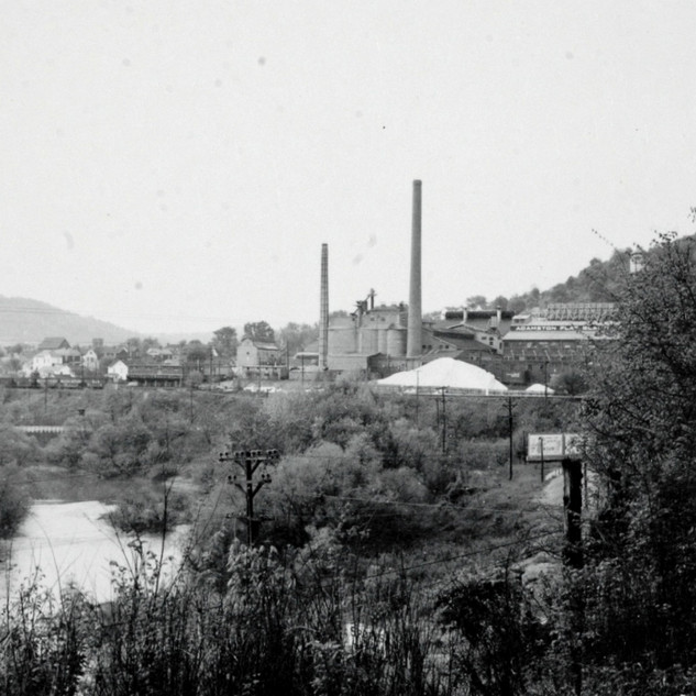 Looking from Rt. 20 along the West Fork river around 1960. Rolland Glass the sister plant would be to the left.