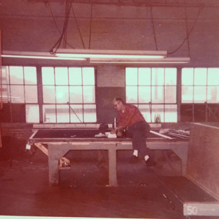 Darel Rhoades eating lunch on his heavy cutting table