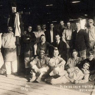 Equitable Window Glass blowing crew 1916.  Gus Quertinmont in  center with suit and tie.