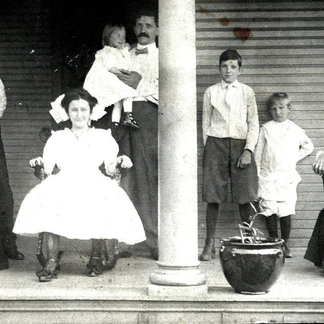 The Jaumot family on Tuna Street, Industrial. Jules Jaumot holding baby was boss cutter at West Fork.  Small boy second from right Jules Jr, glass cutter later and Gene Jaumot, father.