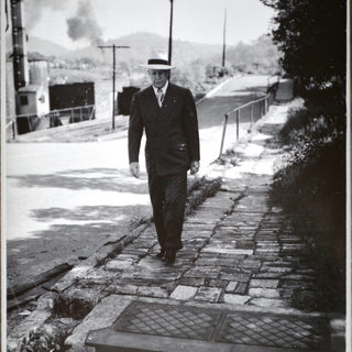 Albert Rolland walking south on North 26th Street from old zinc plant office.