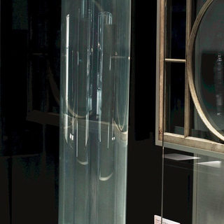 An uncut hand blown cylinder