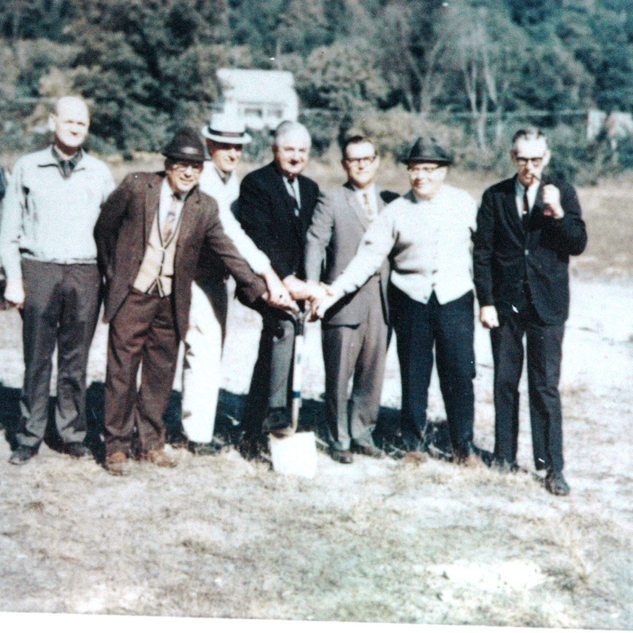 In the late 1960's the Fourco company seen fit for Rolland Glass to have new more efficient cutting room and warehouses.  The location was the Clearlite softball field.  Attending Joff Rolland & president Russell Rice.