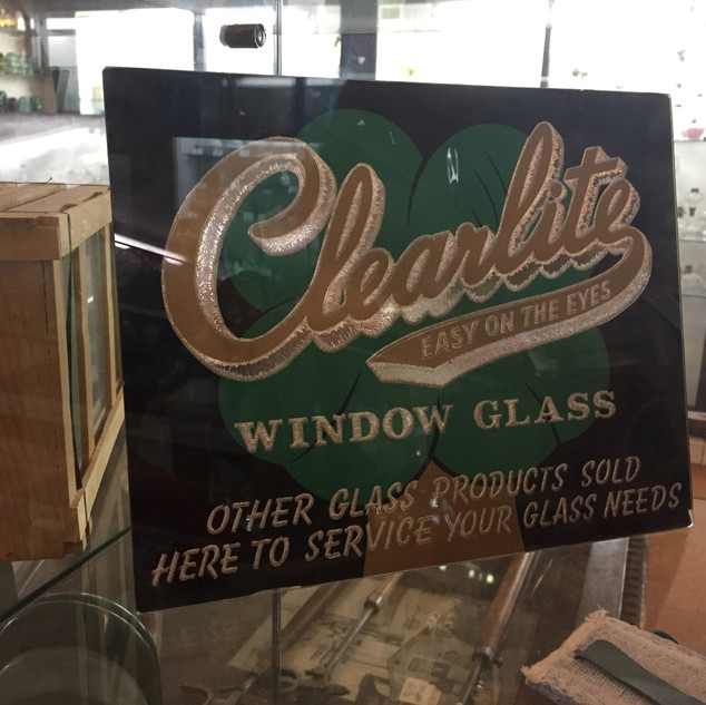 Reverse print on glass sign advertising